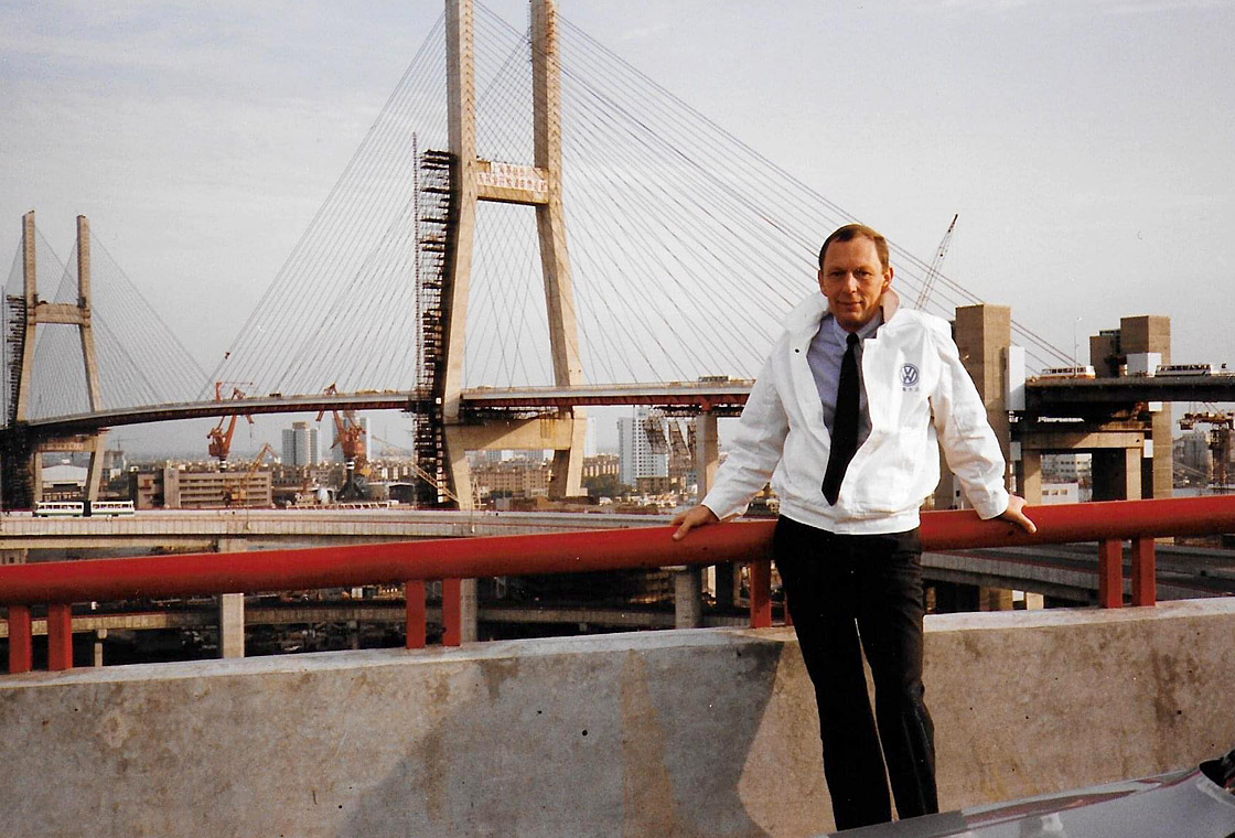 Martin Posth standing in front of a bridge in China